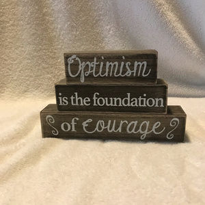 Optimism is the foundation of courage wooden sign